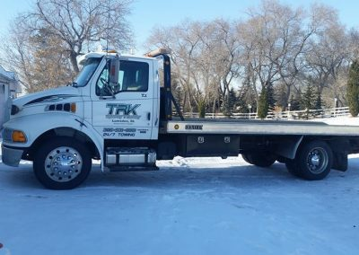 TRK flatbed tow truck