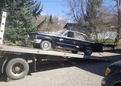 TRK Towing antique car on flatbed